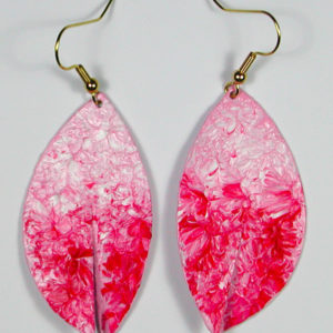 These earrings are a pinkish - strawberry color.