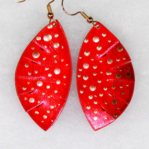 These are candy apple red earrings with various sizes of gold dots. [The picture does not show how beautiful this color combination really is].